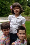 Lila with her brothers.