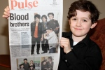 Caleb holding the Danbury News-Times, April 11, 2010