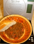 Lentil soup with a chunk of bread